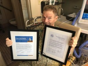 Scott Snedecor with awards from the State of Oregon and Multnomah County - in 2018
